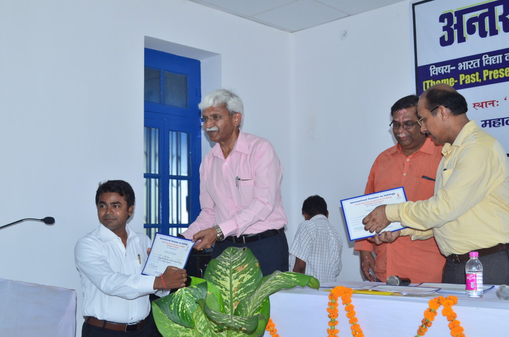 Receiving Certificate of Presentation by Dr. Arvind Agarwaal, Vice-Chancellor of MGCU, Motihari during An International Seminar.